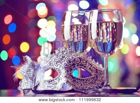 Glasses Of Champagne And Carnival Mask