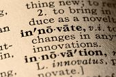 stock photo of pronunciation  - close-up of the word innovate and innovation in a dictionary.