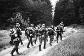 Unidentified re-enactors dressed as World War II German soldiers poster