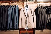 Many Mens Business Suits Of Different Colors poster