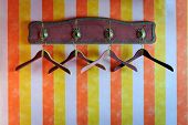 picture of old-fashioned  - Vintage empty hangers on colored striped wall - JPG