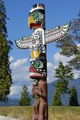 stock photo of indian totem pole  - A totem pole found in Vancouver Canada - JPG
