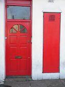 stock photo of front door  - the classic red british door in london - JPG