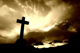 stock photo of holy-spirit  - christian cross silhouette and the clouds in sepia tone - JPG