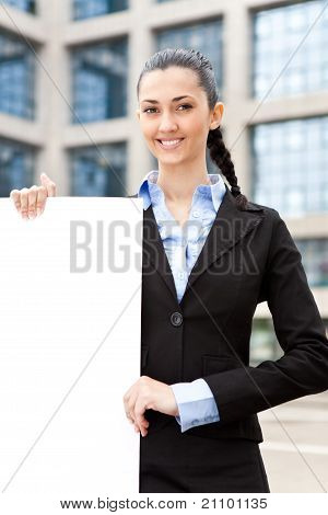 Businesswoman Holding Big Blank Paper
