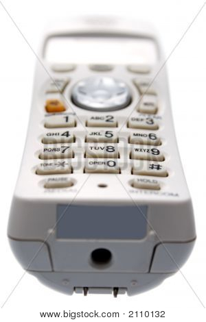 White Cordless Phone. Viewed From The Bottom.
