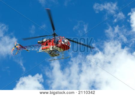 Red Helicopter On The Blue Sky