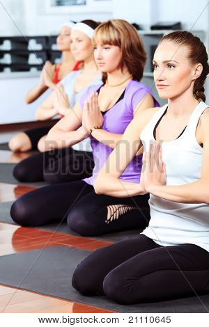 Group of young women in the gym centre. Yoga.