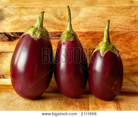Eggplants On Cutting Board