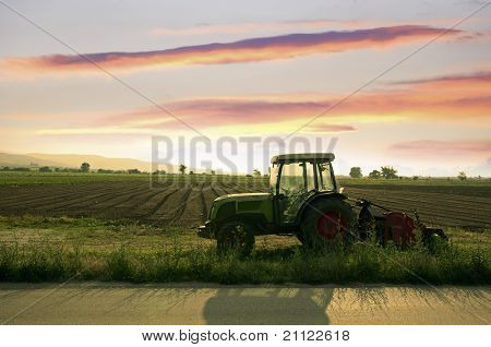 Plowed land and tractor