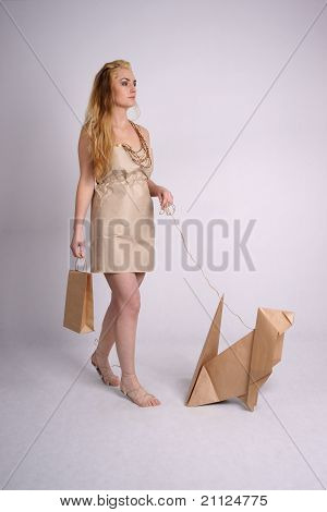 Woman walking eco dog holding eco-friendly bag