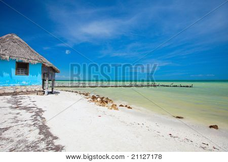 Colorful little house at beautiful tropical coast