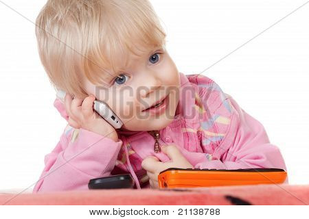 Cute Baby Girl Talking On Mobile Phone Isolated On White.
