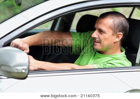Young Man Driving Fast