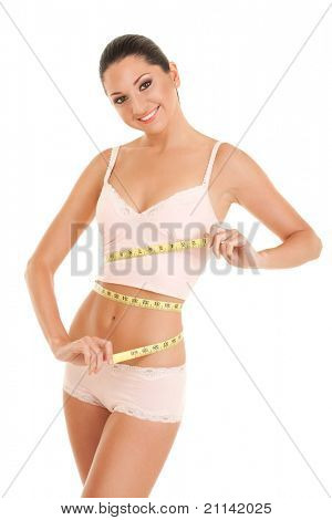 happy young woman with measure tape