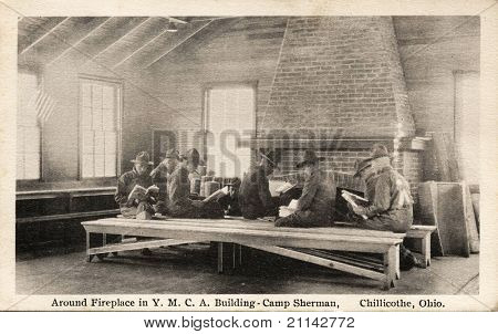 Around Fireplace - Early 1900's WWI postcard depicting soldiers around a fireplace in the Y.M.C.A. Building at Camp Sherman in Chillicothe, Ohio.