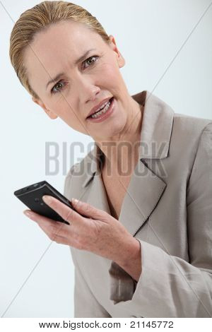 businesswoman holding cell-phone