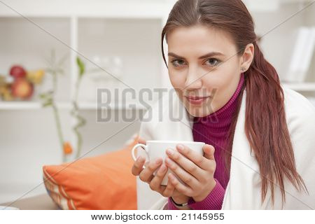 Woman At Home Drinking Tea