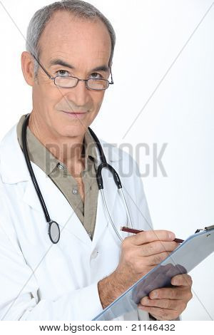 Medical professional writing on a clipboard