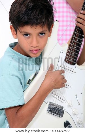 portrait of a child with guitar