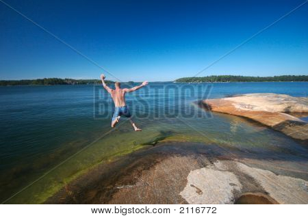 Sweden Jumping Into Water