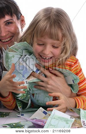 A happy mother with a child holds a money.