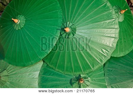 Background of green chinese umbrella. Design.
