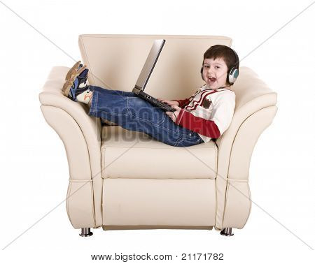 Boy with laptop and headphone. Isolated.
