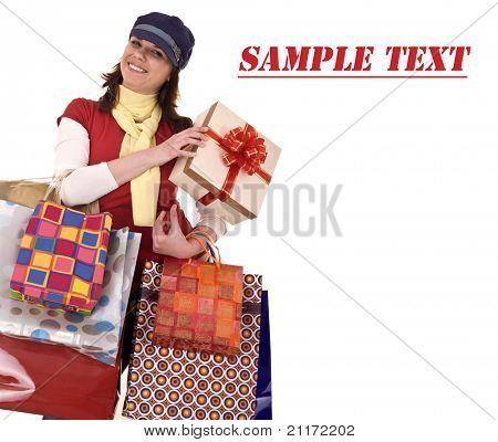 Girl in cap with gift box and bag.Template.