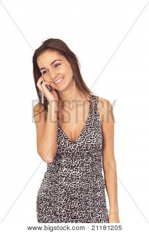 Beautiful Tanned Brunette Girl In A Dress For Kotsktails Talking On Mobile Phone