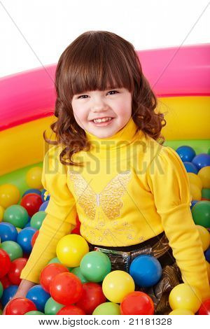 Happy child in group colourful ball. Isolated.