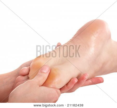 Young woman having foot massage.