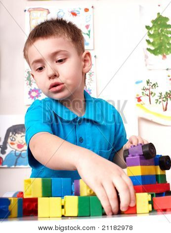 Little boy playing block and construction set.