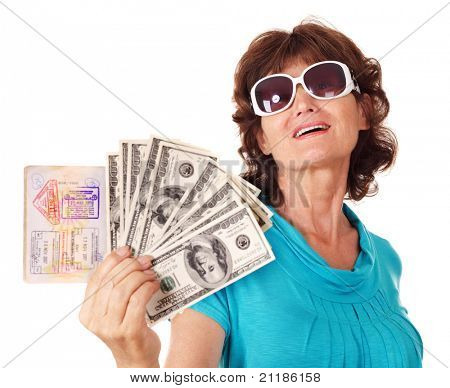 Senior woman holding passport and money. Isolated.