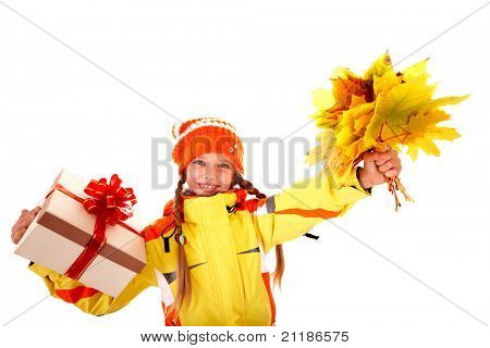 Little girl holding orange leaves and gift box. Isolated.