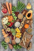 Health food concept for a high fibre diet with fruit, vegetables, cereals, nuts, seeds, whole wheat  poster