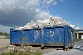 stock photo of waste disposal  - Blue metal waste container with building debris - JPG