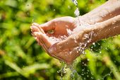 Woman Washing Hand Outdoors. Natural Drinking Water In The Palm. Young Hands With Water Splash, Sele poster