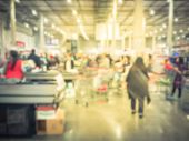 Blurred Long Queue At Wholesale Store Checkout Counter poster