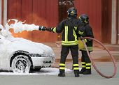 Brave Firefighters With Foaming Fire Off The Car Fire After The poster