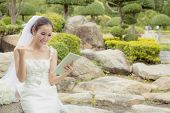 Asian Bride Woman Holding And Show Digital Tablet Feeling So Happiness And Glad. poster