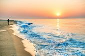 Sunset On The Beach With Long Coastline poster