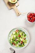Salad. Vegetable salad. Spring vegetable salad. Fresh vegetable salad with tomatoes onion cucumber a poster