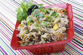 foto of pancit  - Pancit in a Red Ceramic Dish on a colorful background - JPG