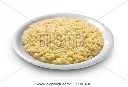 plate of rice, risotto with saffron alla milanese