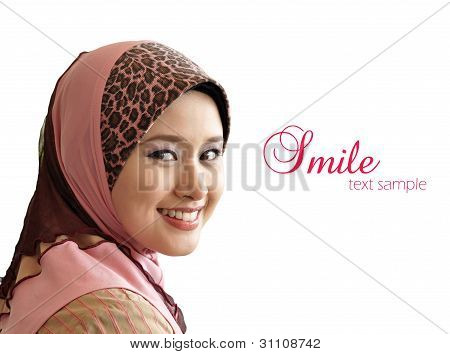 portrait of beautiful young Muslim woman was glanced into the camera with sweet smile