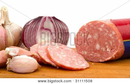 Sliced Sausage With Onion And Garlic