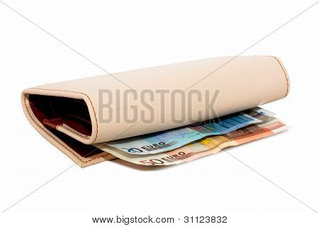 Monetary Denominations Lie In A Wallet On A White Background