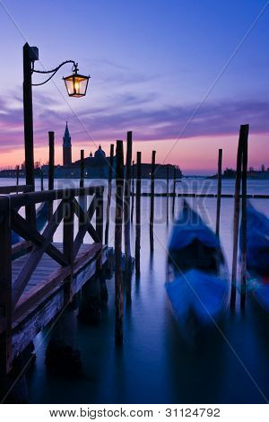 Gondolas Moored By Saint Mark's Square At Dawn In Venice