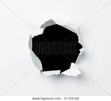 Hole In Paper Sheet